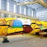 os-gemeos-graffiti-the-brazilian-national-teams-world-cup-plane-designboom-09