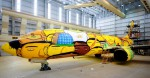 os-gemeos-graffiti-the-brazilian-national-teams-world-cup-plane-designboom-09