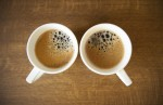 Two whte cups with espresso