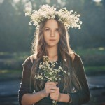 Portrait of beautiful young girl outdoors in summer