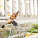 woman-grocery-shopping-using-smartphone-web