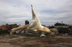 Giant statue of U.S. actress Marilyn Monroe is seen at the dump site of a garbage collecting company in Guigang