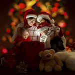 Happy family of four persons in red hats opening lighting bag wi