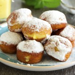 With vanilla cream donuts in powdered sugar.