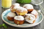 With vanilla cream donuts in powdered sugar.