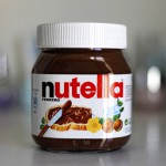PARIS - FEB 22, 2012: Jar of Nutella Hazelnut on a bokeh backgro
