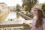 Girl on the bridge with symbolic padlocks