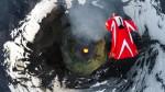 Polet z wingsuit obleko nad vulkanom