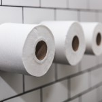 three-rolls-of-toilet-paper-on-white-tile-wall_4460x4460