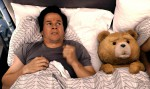 Mark-Wahlberg-Sleeping-with-Teddy-Bear-Movie-Scene-Images-27473234