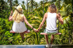 back-view-photo-of-couple-on-swings-holding-hands-2292866
