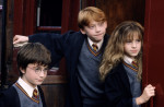 HarryPotter_WB_F1_HarryRonHermioneHogwartsExpress_Still_080615_Land