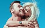 smiling-woman-piggyback-riding-smiling-man-1279344