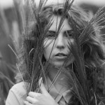 grayscale-photo-of-woman-standing-in-a-wheat-field-4667768