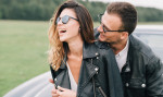 happy-couple-wearing-leather-jackets-4541663