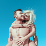 smiling-woman-piggyback-riding-smiling-man-1279344