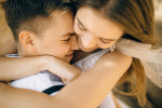 close-up-photo-of-woman-hugging-her-man-while-smiling-4693221