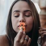 portrait-of-woman-kissing-orange-flowers-3115637