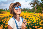 woman-holding-yellow-petaled-flowers-1547094